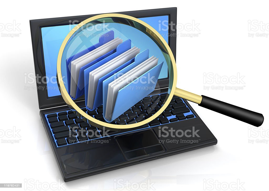 Folders on laptop viewed through magnifying glass royalty-free stock photo