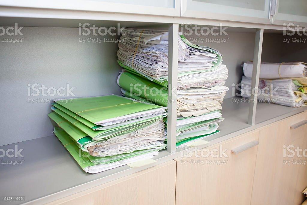 folders on shelf stock photo