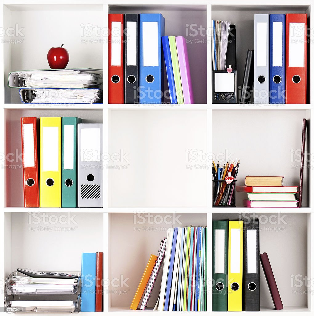 Folders on shelves stock photo