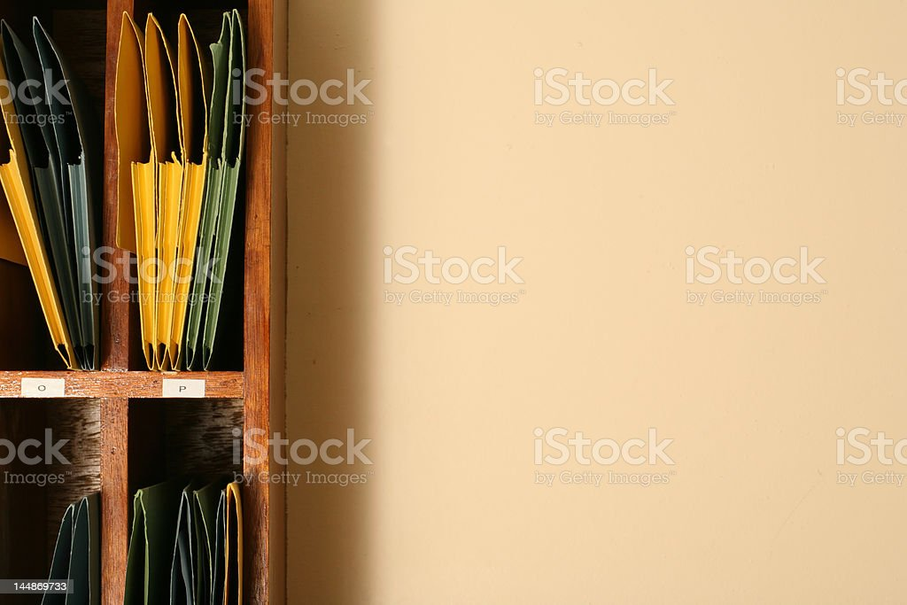 folders with files on a shelf stock photo