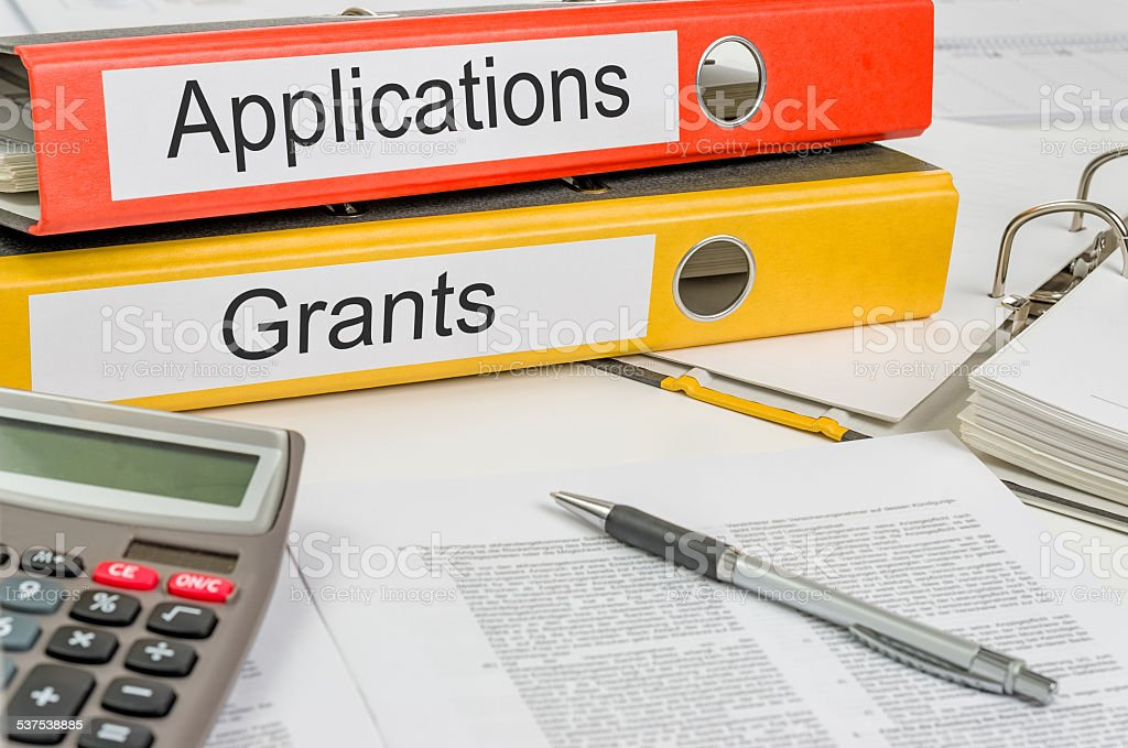 Folders with the label Applications and Grants stock photo