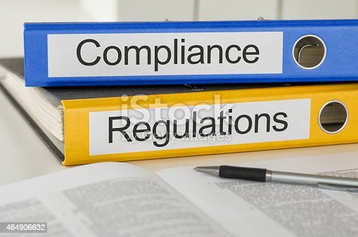 464906632 istock photo Folders with the label Compliance and Regulations 464906632