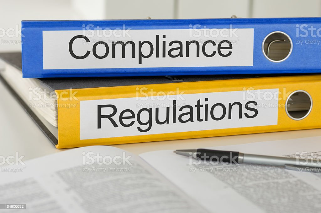 Folders with the label Compliance and Regulations stock photo