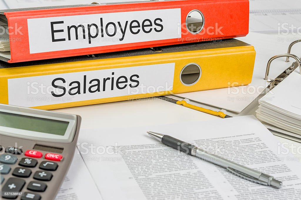 Folders with the label Employees and Salaries stock photo