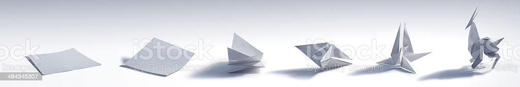 Folding an Origami Animal stock photo