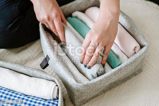 Wardrobe storage system. Clean up clothes with konmari method (Marie Kondo)