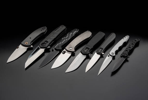 folding knives on a black background. pen knives on a dark background folding knives on a black background. pen knives on a dark background switchblade stock pictures, royalty-free photos & images
