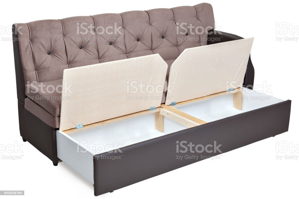Folding light brown fabric sofa bed with storage. stock photo
