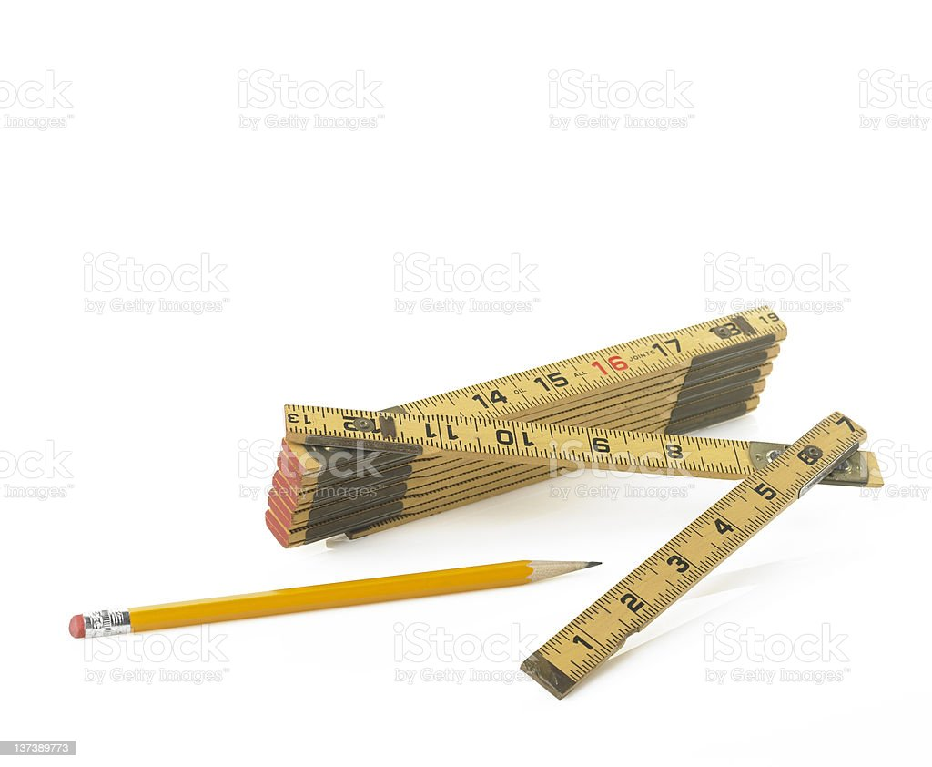 Folding Ruler and a yellow pencil stock photo