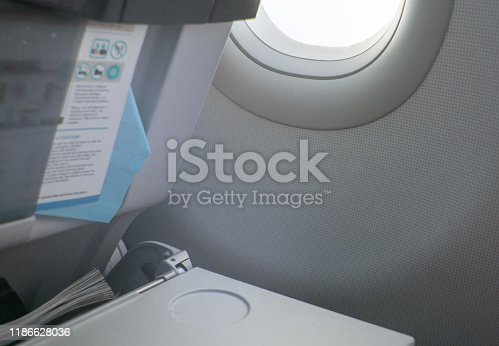 istock Folding table, flight instructions, magazine in the front seat, porthole, concept of flights and travel 1186628036