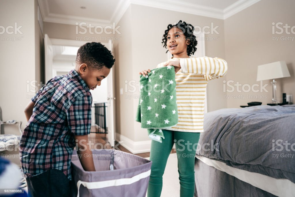 Folding towels with sister stock photo