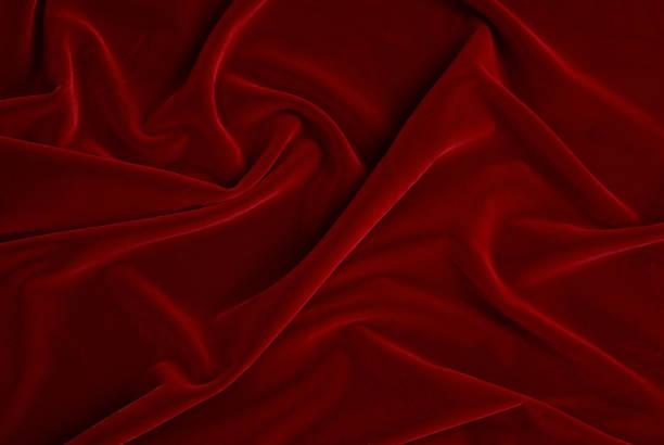 Folds in red velvet stock photo