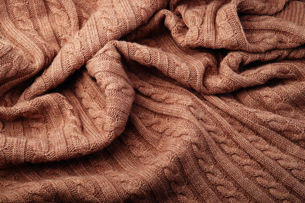 Folds of a knitted woolen blanket, top view stock photo