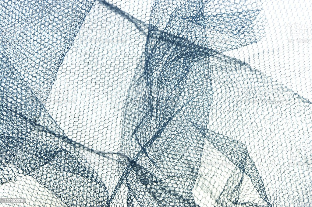 Folds Of Blue Net Type Fabric royalty-free stock photo