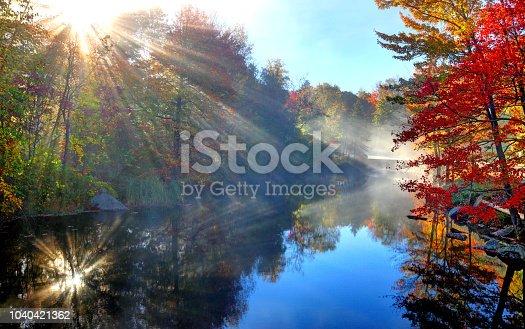 Peak fall foliage along the Sugar River in Sunapee New Hampshire