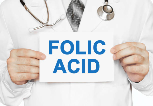 Folic Acid card in hands of Medical Doctor stock photo