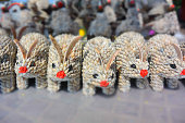 """folk art figurines of rabbits made from seashells on the market in cambodia, siem reap""""n"""
