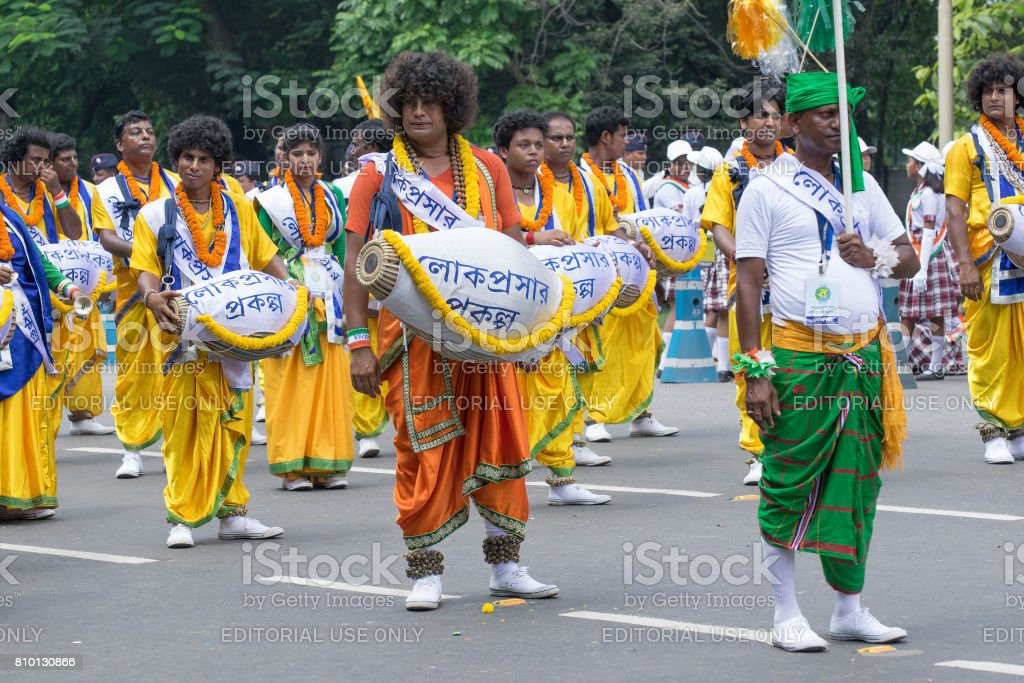 Folk dancers marching past stock photo