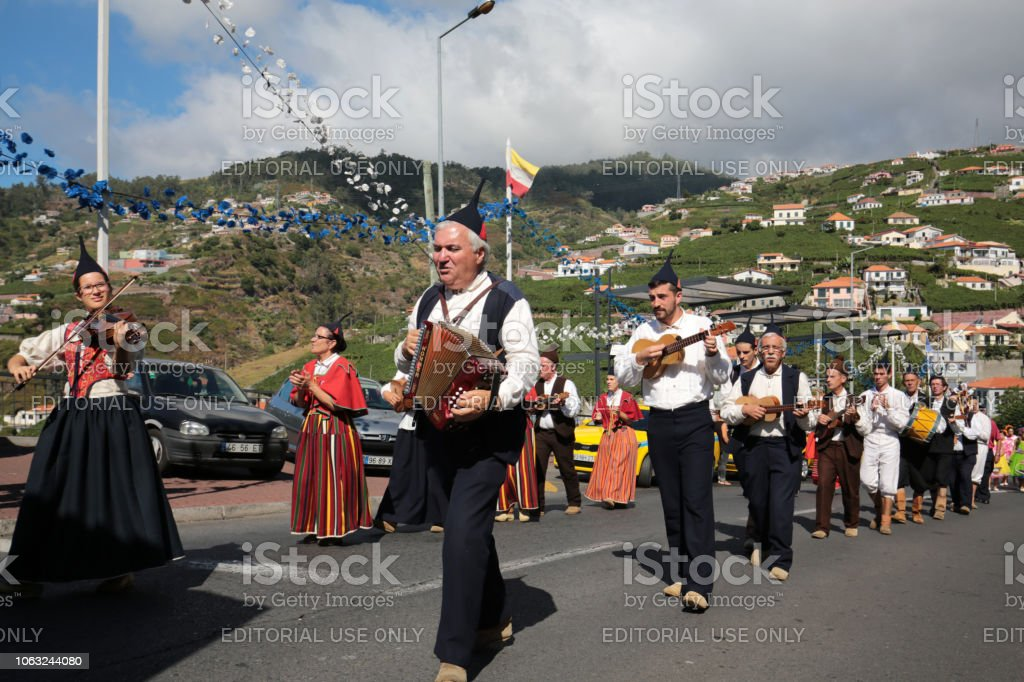 Folk music group in local costumes performs a folk dance at Madeira...