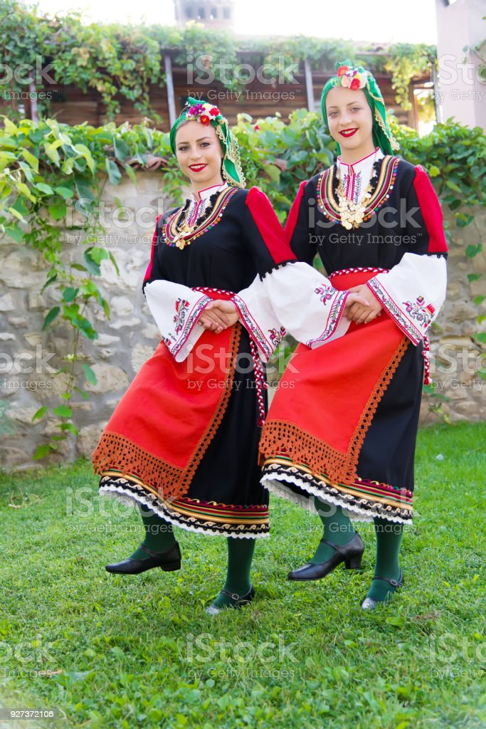 Folklore. Beautiful young people in folk costumes. Folklore. Beautiful young people in folk costumes. Art Stock Photo