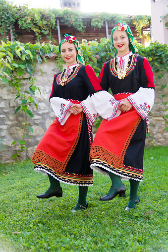 Folklore Beautiful Young People In Folk Costumes Stock Photo - Download Image Now