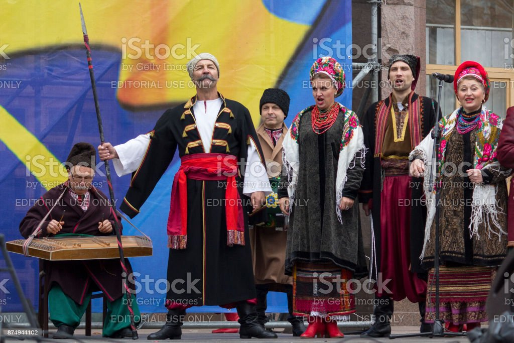 Folklore ensemble in folk clothes performing at the concert on the anniversary of the creation of the Ukrainian army on Khreshchatyk street stock photo