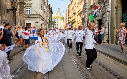 Panama Folklore group dancing down streets during closing the Parade of Etnovyr Festival in street of Lviv. Lviv, Ukraine - August 25, 2019