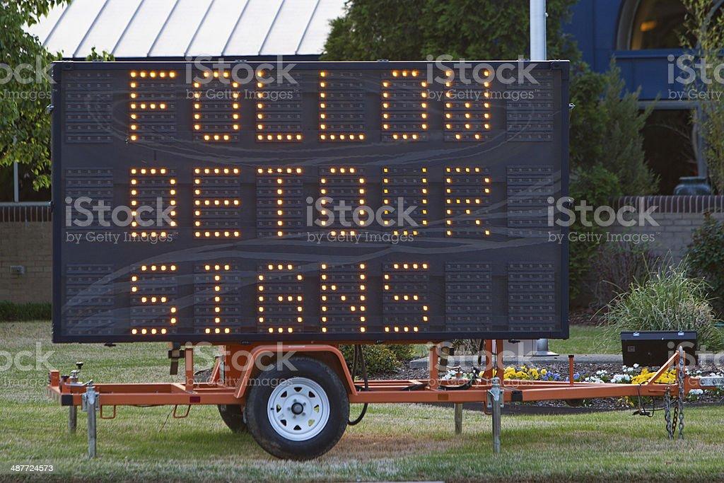Follow Detour Signs stock photo