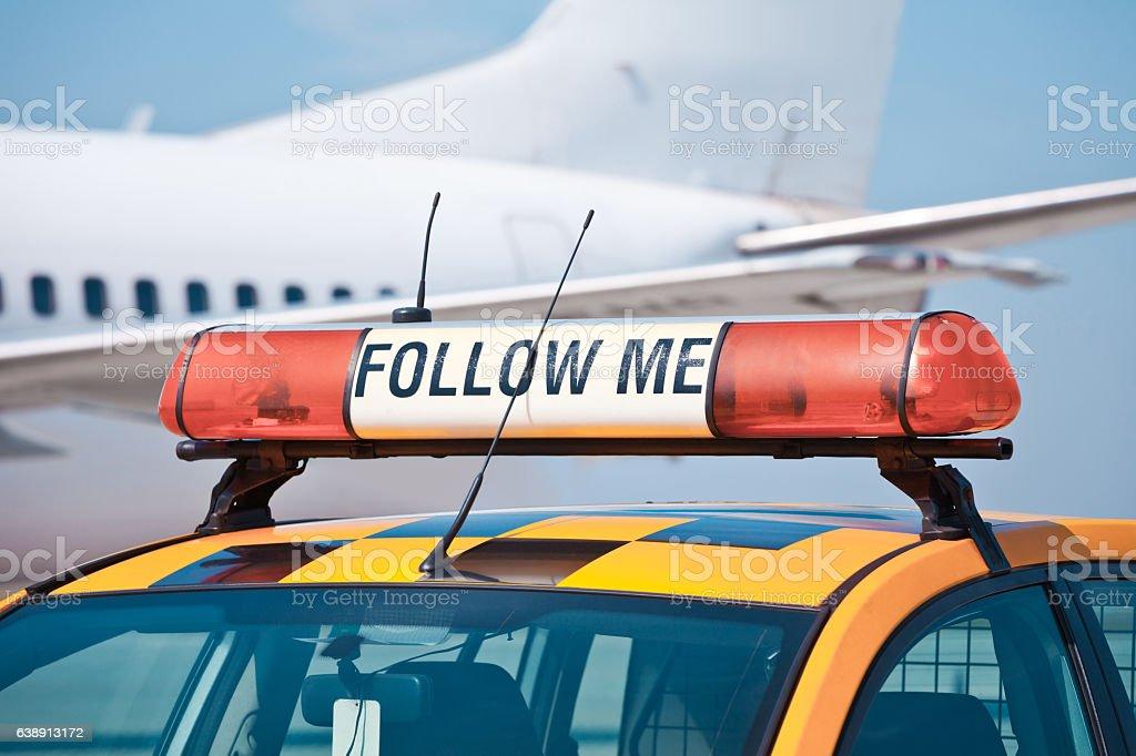 Follow me car at the airport Follow me car at the airport Air Vehicle Stock Photo