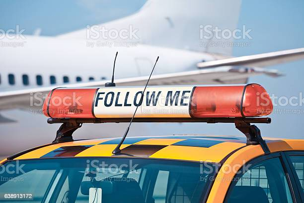 Follow Me Car At The Airport Stock Photo - Download Image Now