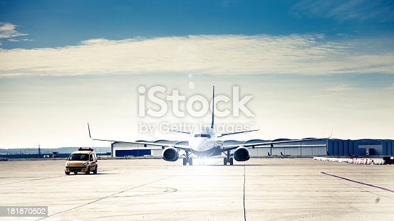 istock Follow me car taxiing an Airbus in the airport 181870502