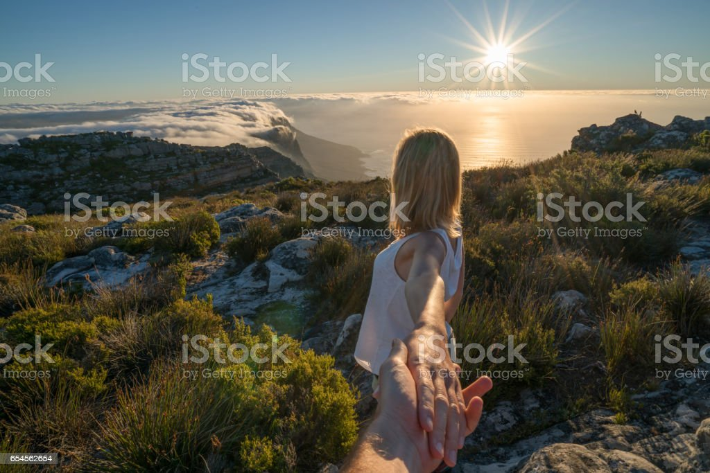 Follow me concept-Hiking over the clouds stock photo