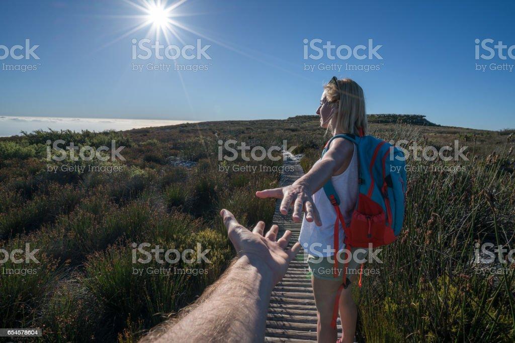 Follow me concept-Hiking woman stock photo