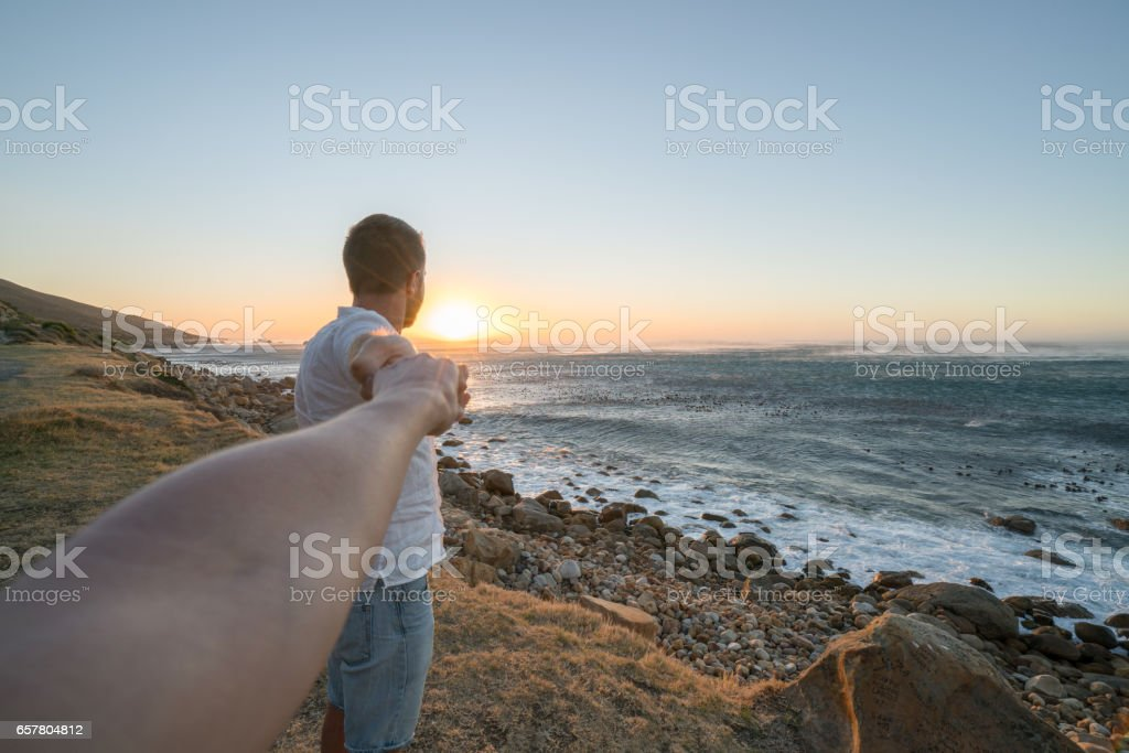 Follow me concept- One young man holding woman\'s hand leading her to...
