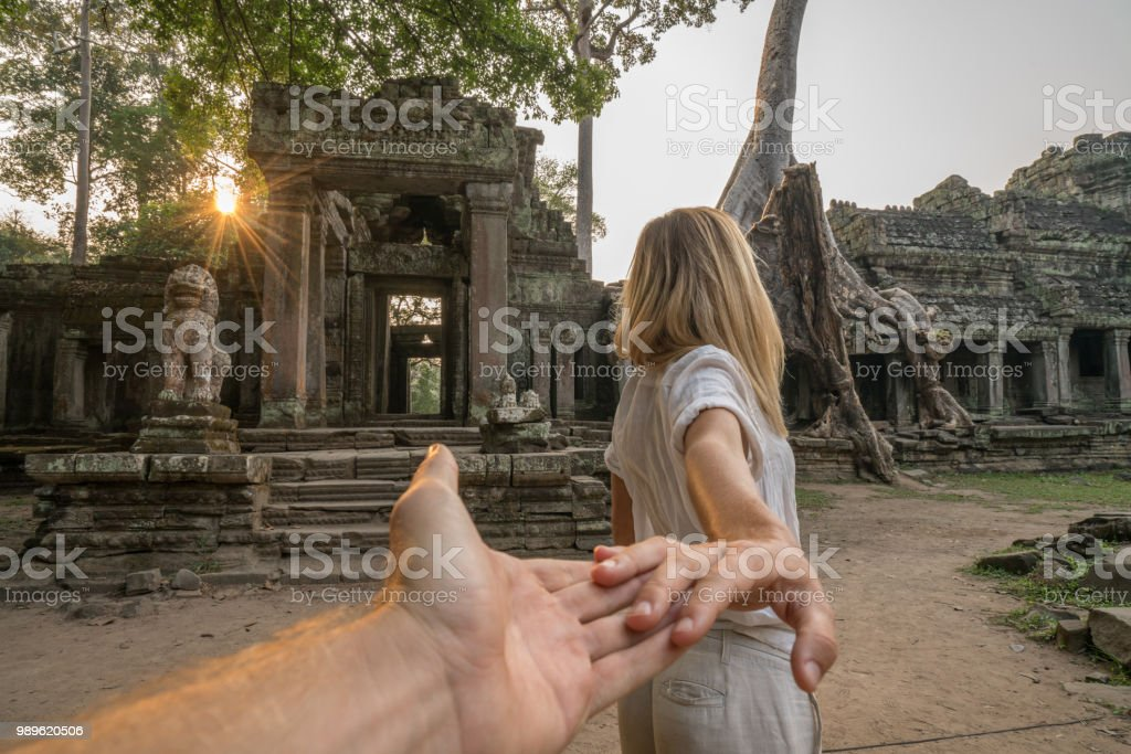 Follow me to concept, woman leading boyfriend to ancient temple,...