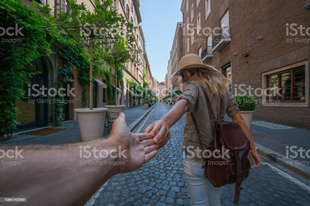 Follow me to Rome; Girlfriend leading boyfriend to the city streets...