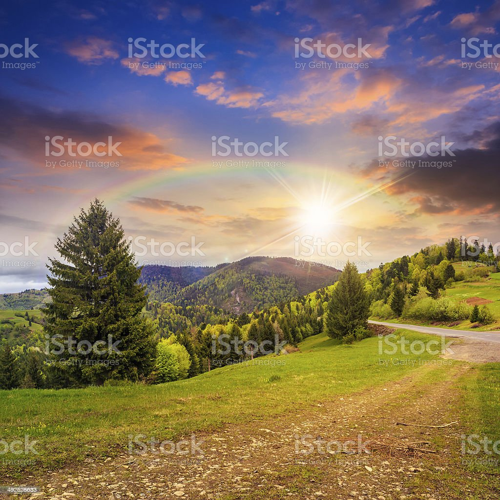 follow the rainbow in high land at sunset stock photo