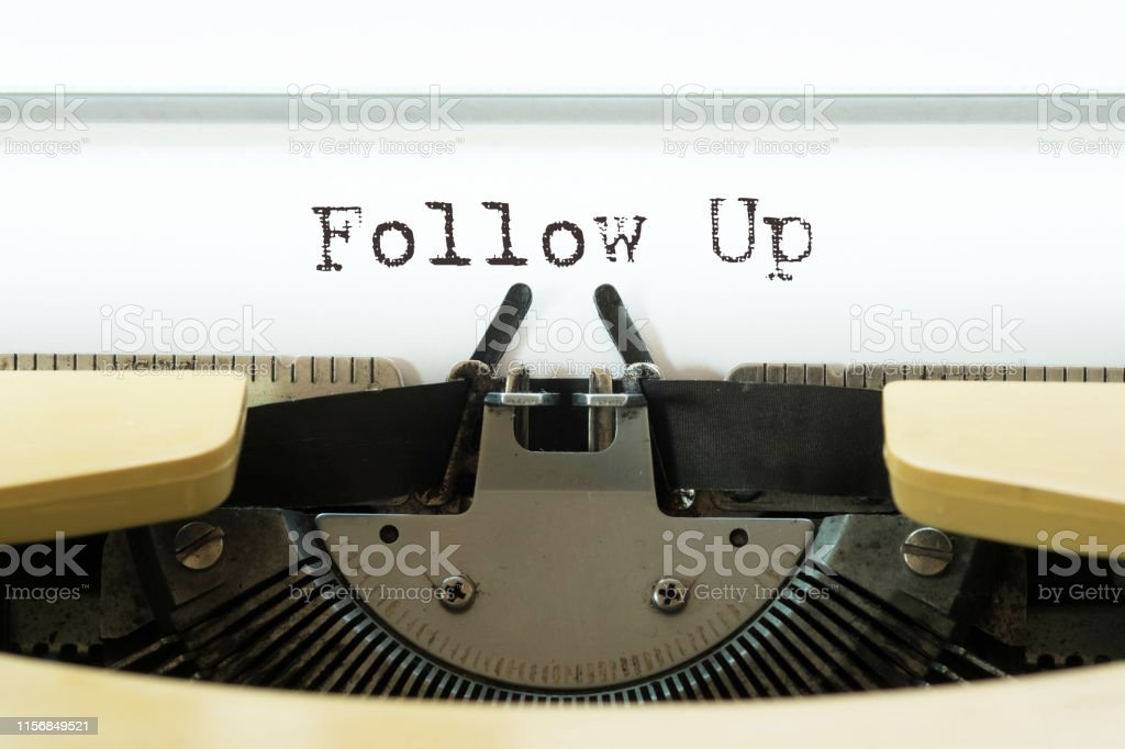 Follow up word typed on a yellow vintage typewriter. Business concept.