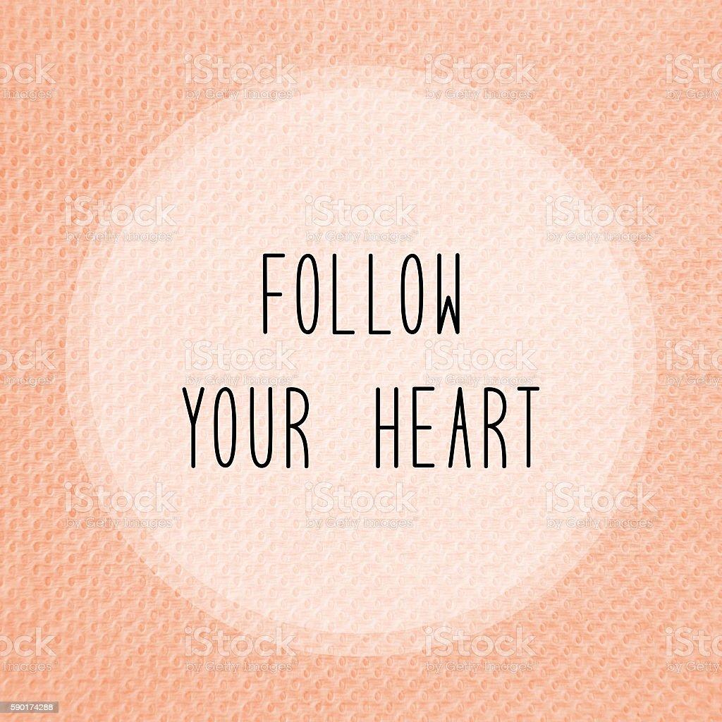Follow your heart on orange tissue paper stock photo
