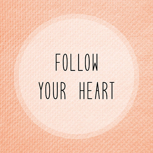 follow your heart on orange tissue paper - herz zitate stock-fotos und bilder
