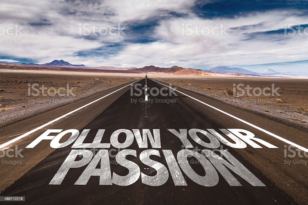 Follow Your Passion written on desert road stock photo