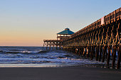 Folly Beach Pier in Charleston, South Carolina is known for its beaches, sandy shore, surfing, and swimming if you don't mind the many jellyfish. What a pleasant time you will have sinking your toes in the sand and frolicking in the surf.