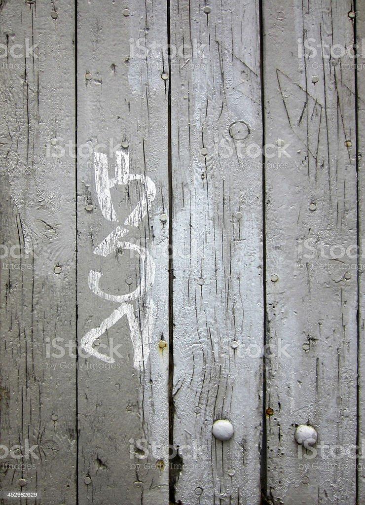 Fond - ancien volet en bois avec tag stock photo