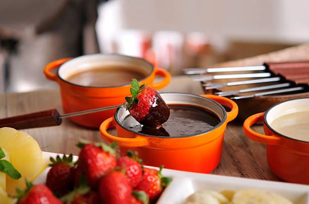 Fondue with fruit and chocolate stock photo