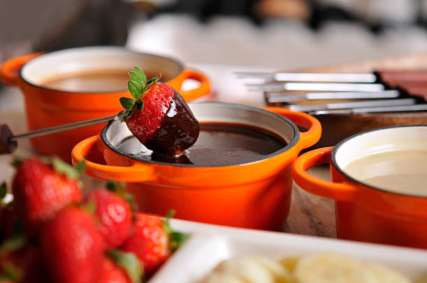 Fondue with strawberry and chocolate stock photo