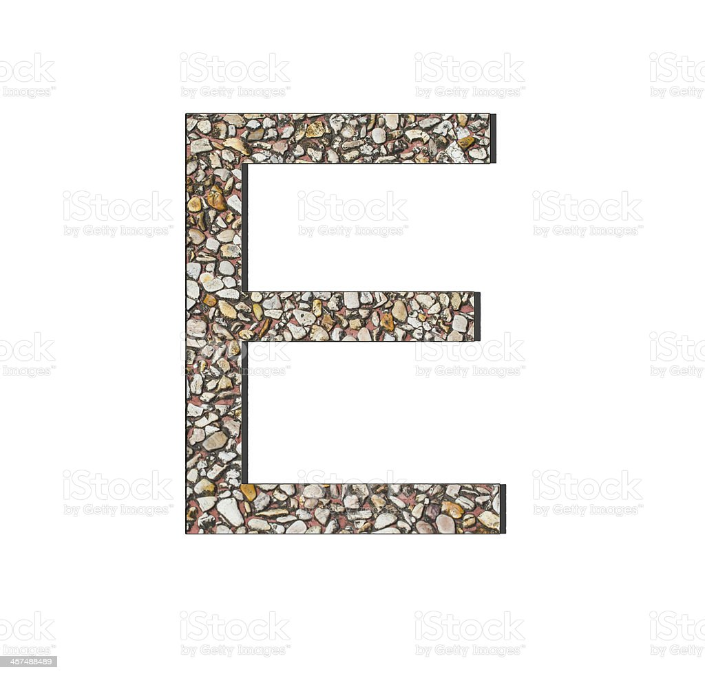 Font from old and weathered stone wall texture royalty-free stock photo