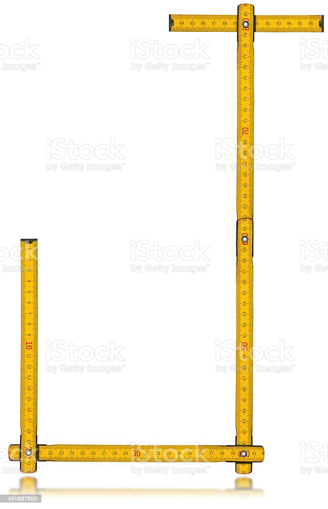 Font J - Old Yellow Meter Ruler stock photo