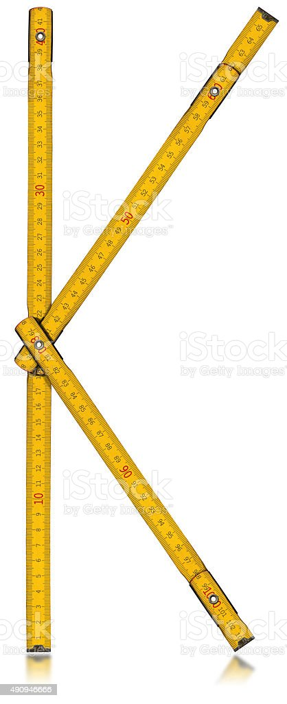 Font K - Old Yellow Meter Ruler stock photo