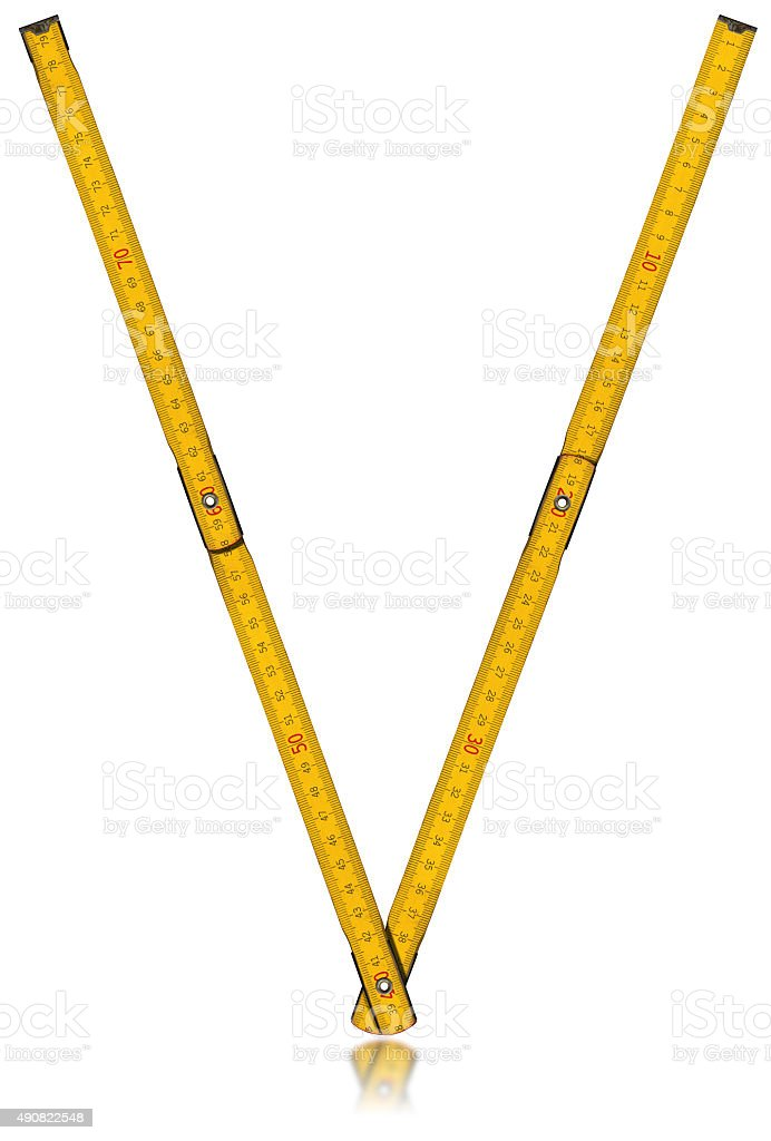 Font V - Old Yellow Meter Ruler stock photo
