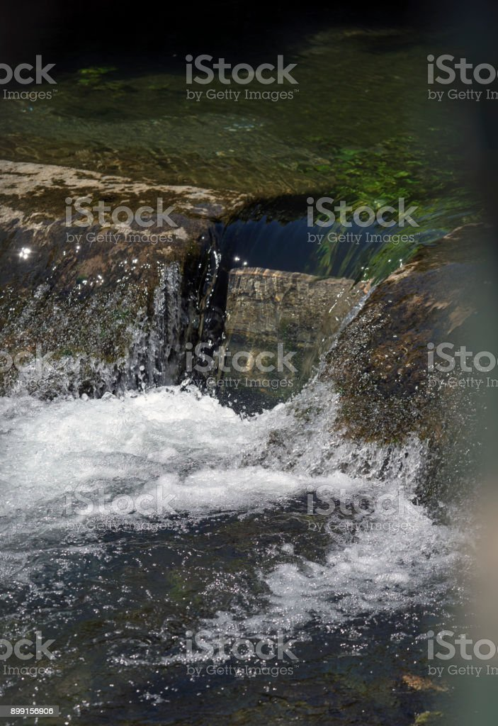 Fontaine de Vaucluse, Luberon, rushing waters from the deep subterranean spring stock photo